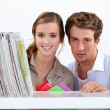 Young couple in library — Stock Photo #14558143