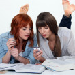 Stock Photo: Two young women studying together