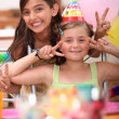 Two little girls on a birthday party — Stock Photo
