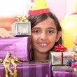 Girl behind gift packages — Stock Photo