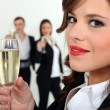 Women in smart suit with glass of champagne — Stock Photo