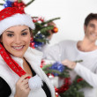 Couple decorating a Christmas tree — Stock Photo