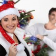 Stock Photo: Couple decorating a Christmas tree