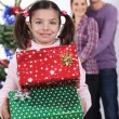 Little girl receiving her Christmas presents — Stockfoto