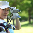 Woman with golf clubs — Stock Photo #14558953