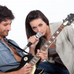 Couple playing music — Stock Photo