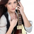 Woman with an electric guitar — Stock Photo