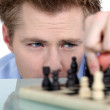 Stock Photo: Man moving chess piece
