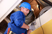 Men examining ventilation system — Stock Photo