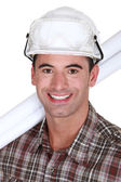 Close-up shot of a grinning tradesman — Stock Photo