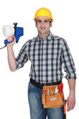 Tradesman holding a spray gun — 图库照片