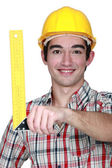 Construction worker holding a try square — Stock Photo