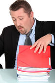 Businessman overwhelmed with work — Stock Photo