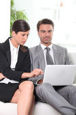 Businesswoman pointing out colleague — Stock Photo
