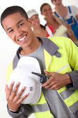 Four young illustrating different occupations — Stock Photo