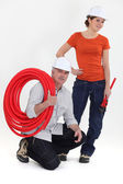 Plumber and young apprentice posing — Stock Photo