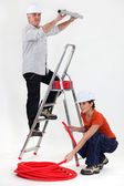 Man and woman doing plumbing work — Stock Photo