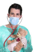 Doctor with a stethoscope and teddy bear — Stock Photo