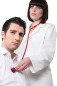 Médico, ouvir uma paciente — Foto Stock