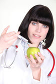 Female doctor injecting apple — Stock Photo