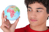 Teen with globe in hand — Stock Photo