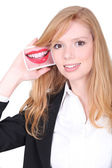Redhead girl smiling with photo of a mouth — Stock Photo