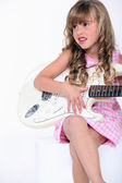 Little blonde girl playing electrical guitar — Stock Photo