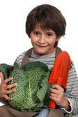 Little boy with cauliflower — Stock Photo