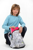 Long haired boy with his schoolbag — Stock Photo