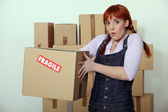 Woman carrying fragile box — Stock Photo