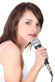 Female would be singer holding microphone — Stock Photo