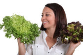 Woman with salad heads — Stock Photo