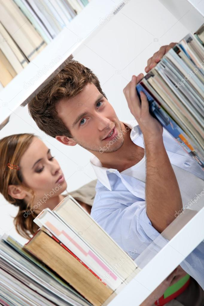 Couple in a library  Stock Photo #14558189