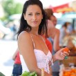 Woman with a basket of market produce — Stock Photo