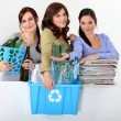 Young women taking out recycling — Stock Photo #14560285