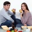 Man and woman eating hamburgers — Stock Photo