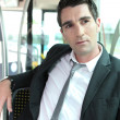 Businessman on public transport — Stock Photo