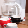 Empty coffee cups and machine — Stock Photo
