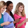 Three female students texting. — Stock Photo