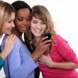 Stock Photo: Girlfriends looking at mobile phone