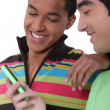 Stock Photo: Teens looking at mobile phone screen