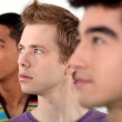 Three young men in profile — Stock Photo