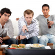 Young men watching football game — Stock Photo #14560743