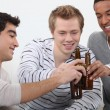 Three friends getting drunk together - Stock Photo