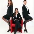 Three young sexy women in smart suit — Stock Photo