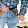 Stock Photo: Carpenter using chisel.