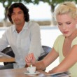 Man and woman having coffee on a terrace — Stock Photo #14563877