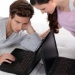 Stock Photo: Young couple with laptops