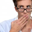 Man with his hand over his mouth. — Stock Photo #14568517