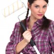 Attractive brunette holding paint roller - Stock Photo